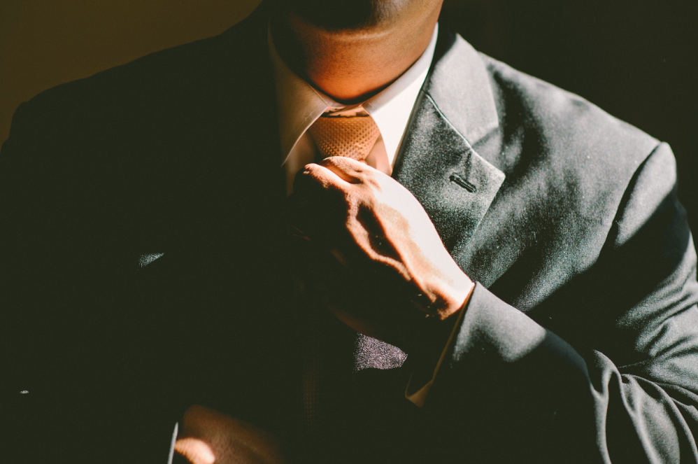 image of a man in a suit getting ready for interview