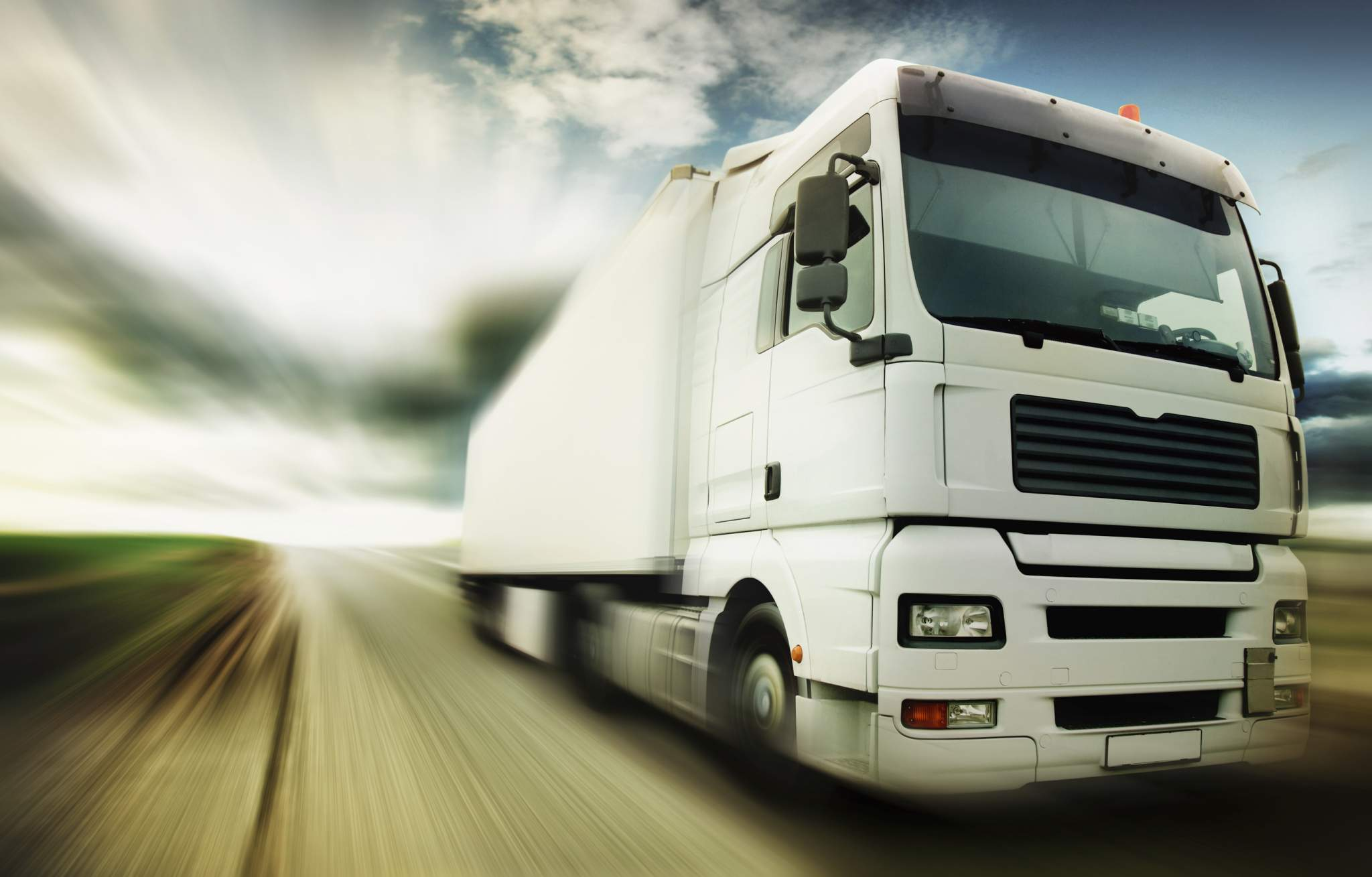 image of a truck driving at speed
