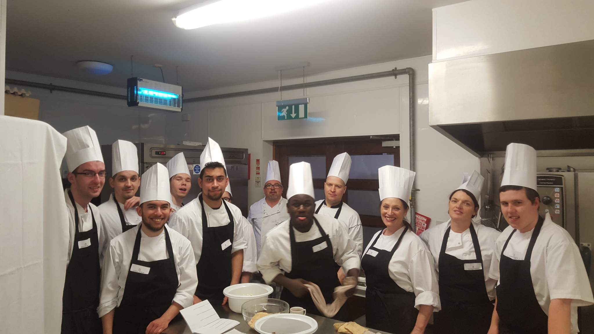 image of a culinary skills group with their chefs hat on