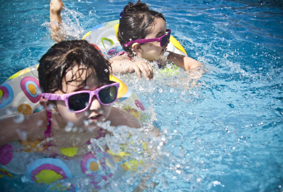 image of 2 children swimming in a pool